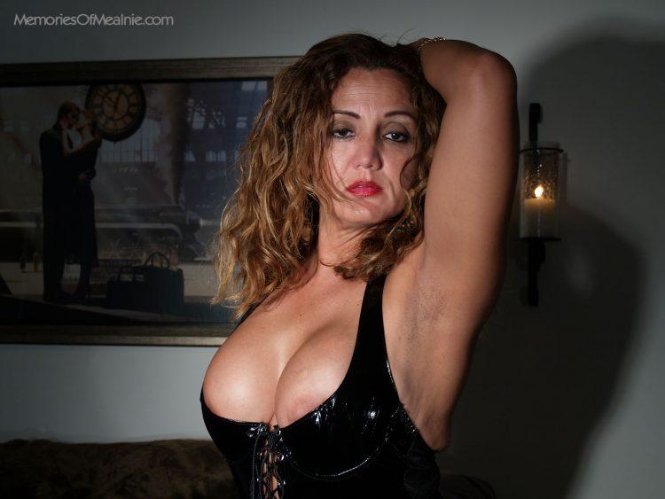 Kneel before Melanie's big boobs and deep cleavage.