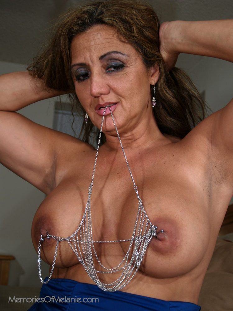 Mature Latina mom with big boobs and large nipples.
