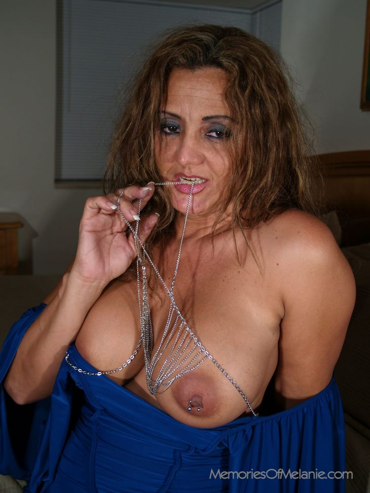 Bedroom milf teases with big boobs, chains and pierced nipples.