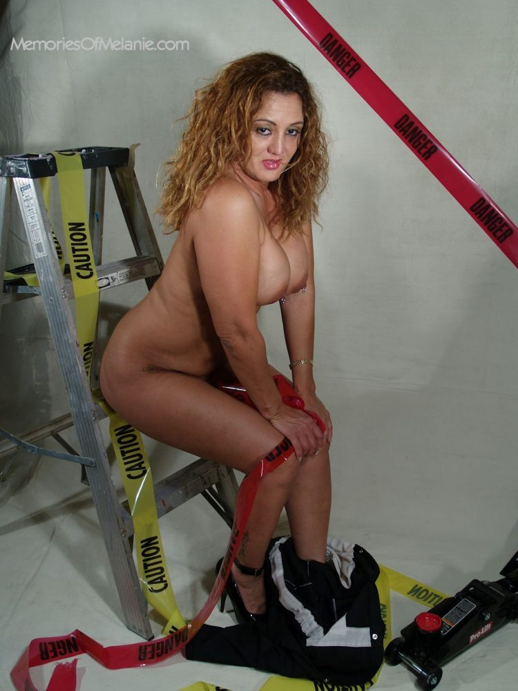 Hot pin-up construction babe waring only heels.