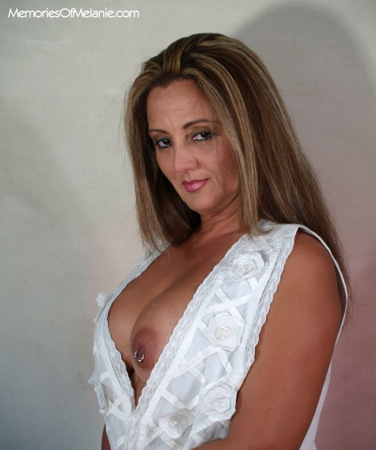 Beautiful mom's pierced nipples peeeking out of her low cut blouse.