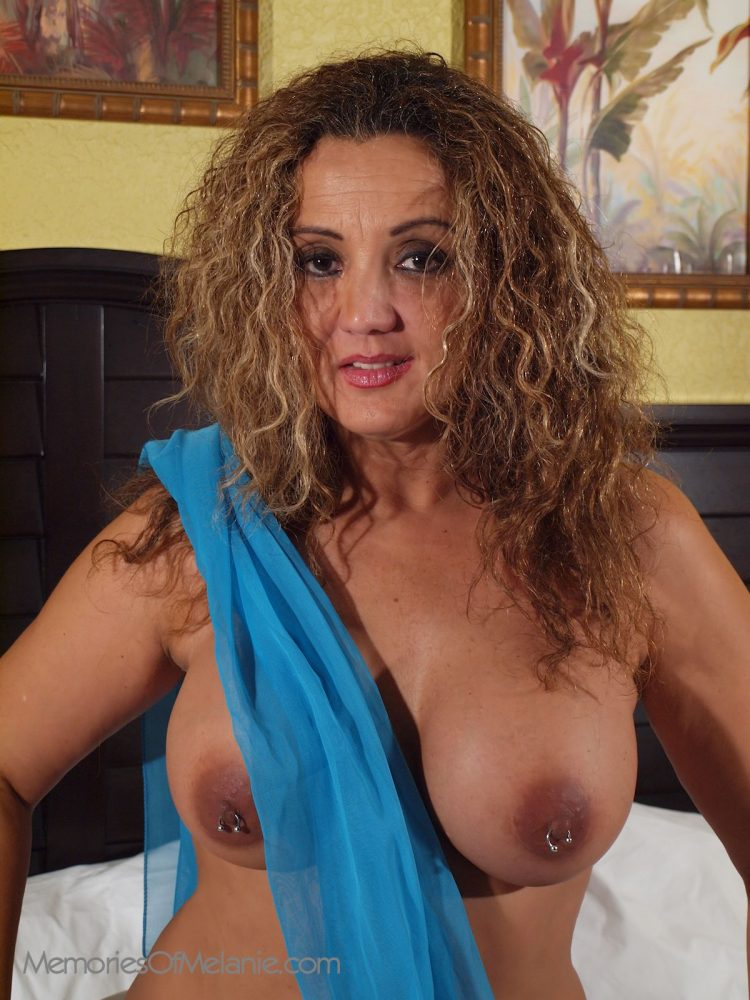 Latina glamour model exposing her boobs and large nipples.