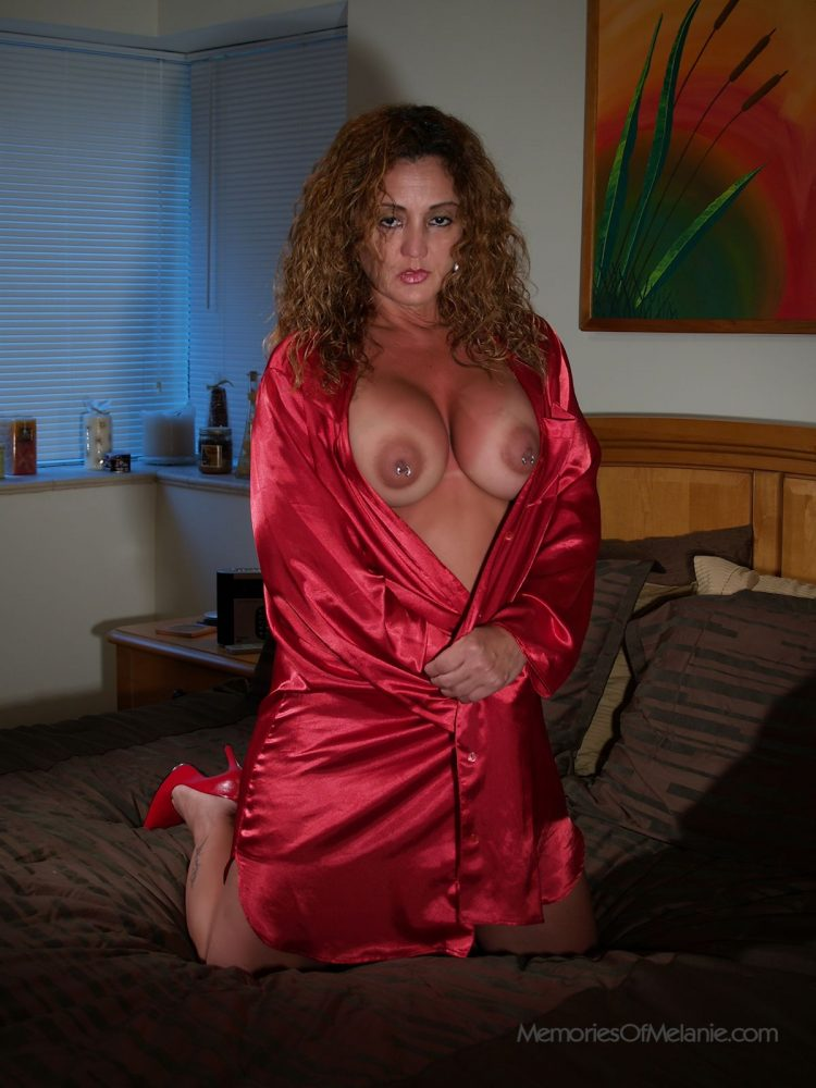 Bedroom mature mom showing her tan lines and firm breasts.