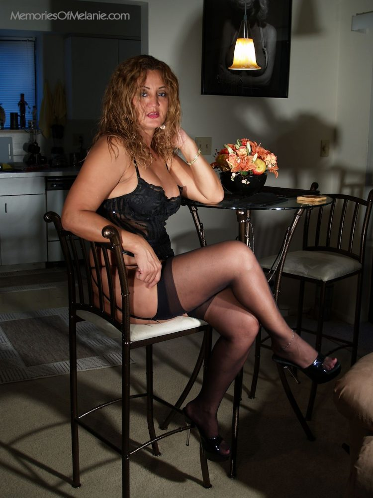 Sexy mom dressed in lacy lingerie, stocking and high heels.
