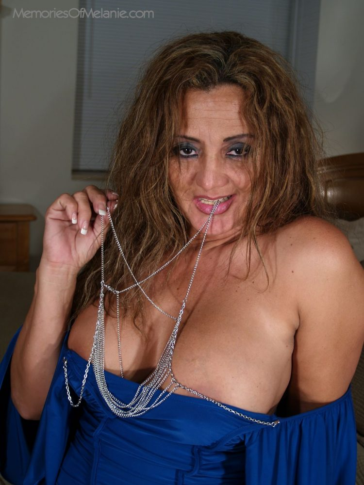 Sexy Latina milf teases with her big boobs and deep cleavage.