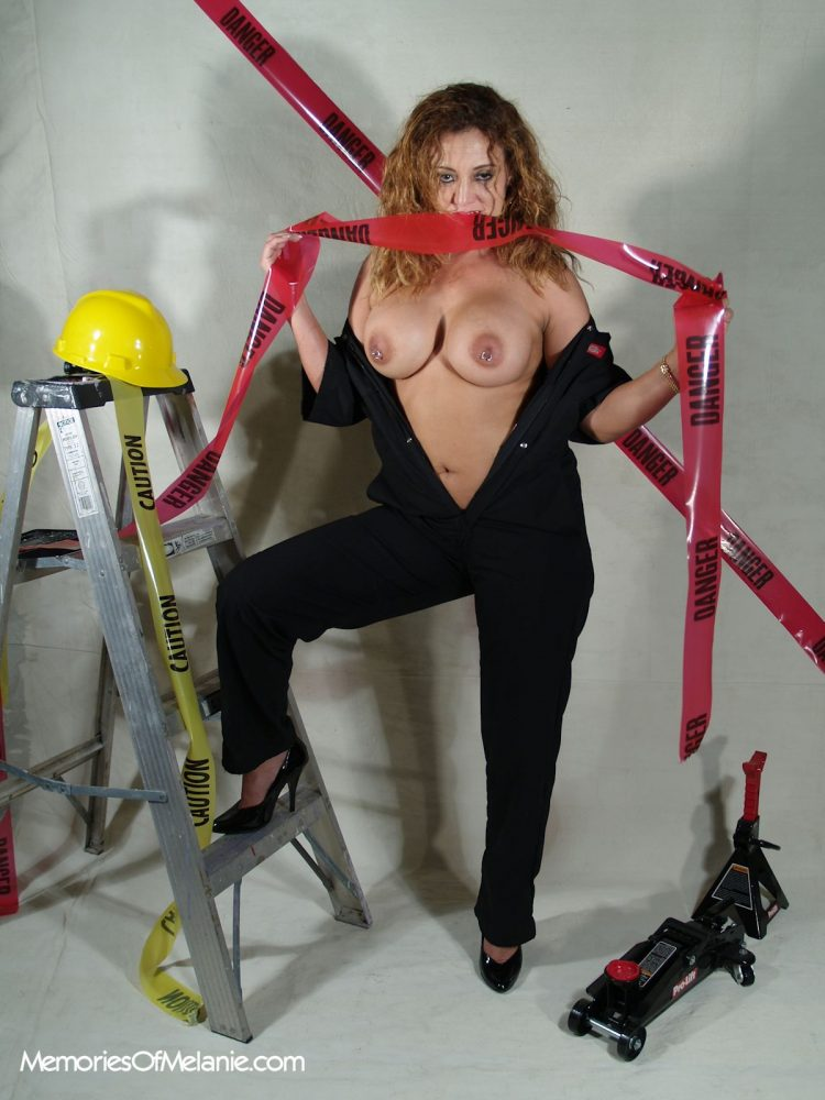 Lady construction worker goes topless and shows off her big boobs and pierced nipples.